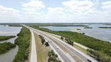 Circular Aerial Of The Mangrove Islands Surrounding The Sunshine Skyway Tollway Road That Crosses Tampa Bay