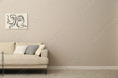 Fototapeta Modern comfortable sofa and picture near wall in room