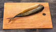 Smoked Atlantic Mackerel Without Head On Cutting Board, Dorsal View