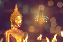 Buddha Image In Temple Fair Light Night With Pagoda In Background