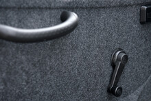 The Interior Of The Car Door With Handles For Opening The Door And Window.