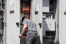 Electrician Engineer Working On The Electrical Distribution Board. Repair Works, Street Lighting System