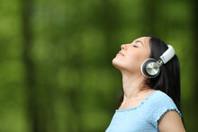 Asian Woman Breathing Listening Music With Headphones