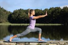 Woman Practicing Tai Chi Pose In A Lake