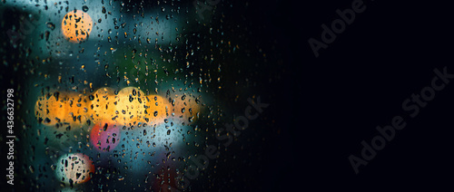 Fotografia Rain drop on window at night