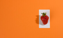 Red Ripe Strawberries On An Orange Background