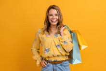 Beautiful Attractive Smiling Woman In Yellow Shirt And Jeans Holding Shopping Bags