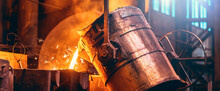 Metal Cast Process, Long Banner Image. Molten Liquid Iron Pouring From Ladle Container Into Mold.