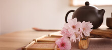 Pot, Sakura Flowers And Bamboo Coasters For Traditional Tea Ceremony On Table. Banner Design
