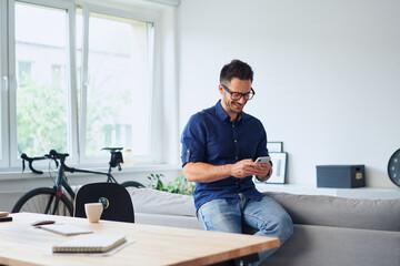 Man using phone having break from work from home