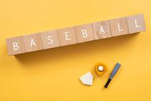野球、ベースボール|「BASEBALL」と書かれた積み木と野球道具のおもちゃ