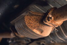 Vehicle Underbody Exhaust Pipe, Catalyst, Resonator, Exhaust System. Old Parts Require Repair And Replacement. Car Service And Maintenance. Standards And Technical Condition. Selective Focus