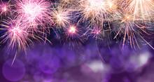 Beautiful Bright Fireworks Lighting Up Night Sky. Bokeh Effect