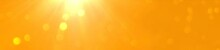 Abstract Orange Background With Sun And Bokeh Lights