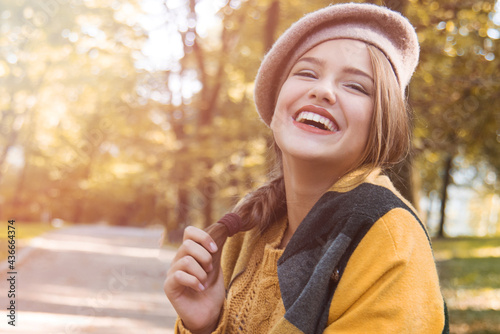 Young beautiful woman in autumn park Poster Mural XXL