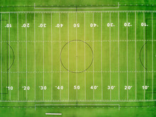 An Aerial View Of A Football Field Showing The Yard Lines.
