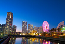 View Of The Modern Skyline In Minato Mirai, Yokohama During The Sunset In Front Of The Waterfront.
