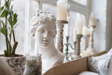 Woman Statue Bust And Candlesticks On Windowsill