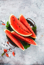 Watermelon Slices With Ice Cubes On Metal Tray And A Wooden Rustic Background. Top View, Blank Space