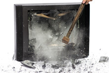 Hammer Blow To Television, Shards Flying Away, White Background. Breaking TV Screen.