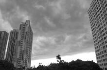 Incredible Dark Gray Nimbus Clouds Over Skyscrapers Before The Heavy Rain In Monochrome