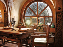 Fantasy Tiny Storybook Style Home Interior Cottage With Rustic Accents And A Large Round Cozy Window. 3d Rendering