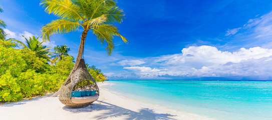 Tropical beach paradise as summer landscape, beach swing hammock and white sand, calm sea serene beach. Luxury beach resort hotel vacation holiday. Exotic tranquil island nature travel destination
