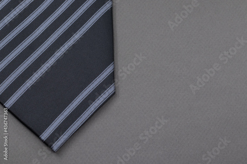 Striped tie or necktie or cravat isolated on grey background, copy space for text, Happy Father's Day concept idea Fototapet
