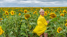 Joyful Adult In A Yellow Dress With A Beautiful Smile On The Background Of Sunflowers With Blue Clouds On A Summer Day Fashion Sunflower Yellow, Portrait Woman Field Red Print, Drawing Flower