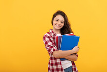 Teen Girl Ready To Study. Happy Childhood. Cheerful Kid Going To Do Homework With Books.