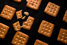 Closeup Shot Of Crackers On A Black Surface