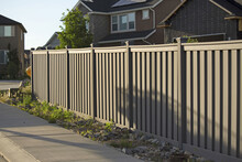 Shot Of The Fence Around The House In The Neighborhood During The Sunset.