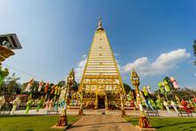 Ubon Ratchathani, Thailand, January 24, 2021: Buddhists Visit The Beautiful Pagoda Wat Phrathat Nong Bua Temple, Ubon Ratchathani Province, Thailand. ASIA.