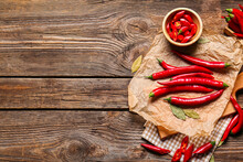 Composition With Hot Chili Pepper On Wooden Background