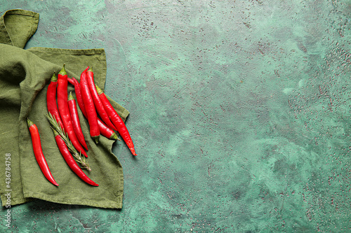 Fotografía Hot chili peppers on color background