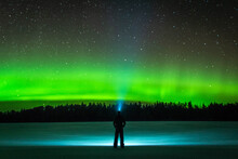Full Length Rear View Of Silhouette Man Standing Against Sky At Night With Northern Lights