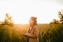 Cheerful Woman Listening Music Standing Outdoors During Autumn