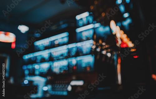 Blurred bar shelves and bar counter with many bottles Fototapeta