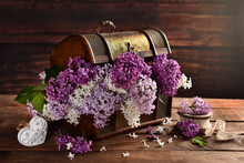 Bunch Of 3 Color Lilac In Wooden  Chest In Rustic Style