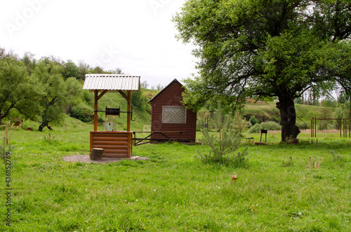 Water well and wooden alcove Fototapeta