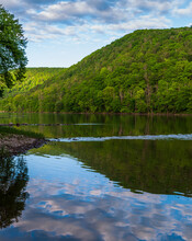 A Valley With The Allegheny River Flowing Through It In Althom, Pennsylvania, USA With The Border Of The Allegheny National Forest At The Far Treeline