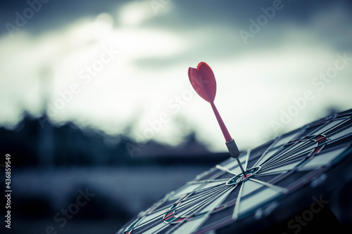 Target with arrows ,Image for target business, marketing solution concept.of dartboard with sky background.