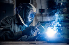 Blue Color Industry Worker Banner. Welder Work With Metal Parts Car In Factory, Sparks And Electricity