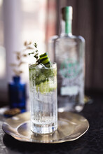 Close Up View Of Gin Cocktail With Fresh Herbs On Steel Plate