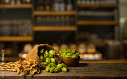 Oktoberfest beer barrel and beer glasses with wheat and hops on wooden table Fototapet
