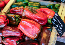 Red And Green Peppers For Sale At The Market.