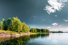 Swedish Nature. Sweden. Summer Lake Or River In Beautiful Summer Sunny Day. Forest Growing On Stone Coast