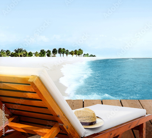 Fototapeta Beach lounger on wooden deck terrace on the beach with beautiful seascape lagoon