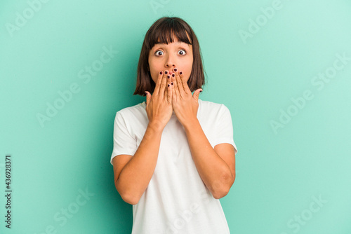 Fotografering Young mixed race woman isolated on blue background praying, showing devotion, religious person looking for divine inspiration