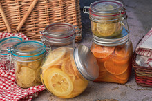 Glass Jars Filed With Fermented Sliced Lemons, Limes, Mandarin Oranges For Cooking And Roasting Recipes